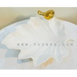 صحن سيراميك بشكل ورقة مزينة بعصفور ذهبي