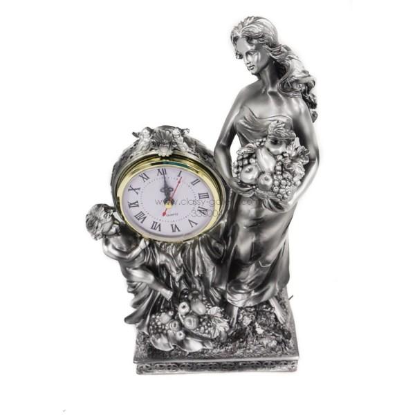 ساعة مزينة بتمثال فتاة